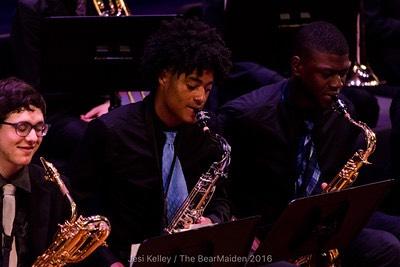 Loughlan McLean playing saxophone in band